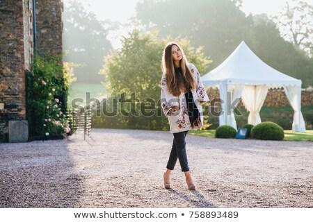 People, travelling and excursions concept. Tall young female stands crossed legs outdoors, has walk  Stock photo © vkstudio