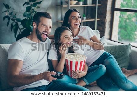 Boldog apa lánygyermek néz tv otthon Stock fotó © dolgachov