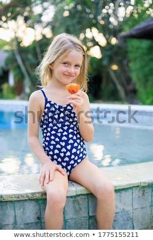 Seduta bella ragazza costume da bagno sottile Foto d'archivio © fotoduki