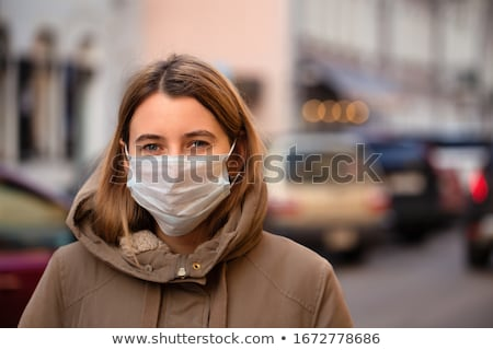 beautiful female wearing mask stock photo © anna_om