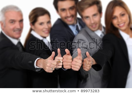 Stock photo: Manager and his team all giving a strong thumbs up