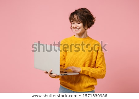 Office brunette woman with pink Laptop isolated on white