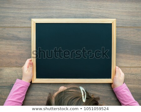 young child holding wooden board stock photo © gewoldi