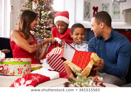 Father giving daughter Christmas present Stock photo © photography33