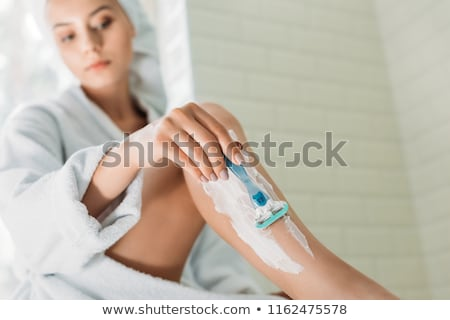 Woman shaving legs Stock photo © Ariwasabi