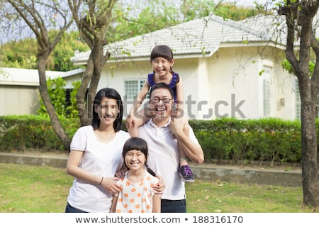 Asian couple in front of their house Stock photo © aremafoto