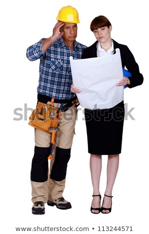 Unhappy and puzzled tradesman and engineer looking at a blueprint Stock photo © photography33