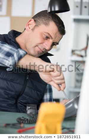 Artisan sitting on toolbox Stock photo © photography33
