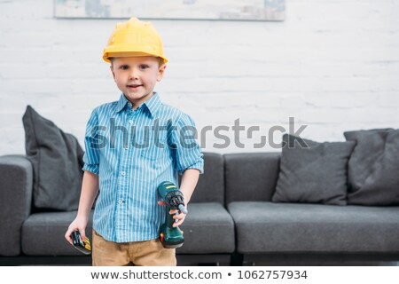 Little boy with toy drill pretending to be workman Stock photo © photography33