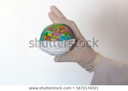 Doctor holding world globe Stock photo © photography33