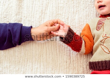 Stock photo: Father shaking his finger at a small daughter