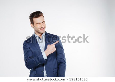 smiling business man in suit pointing right stock photo © scheriton