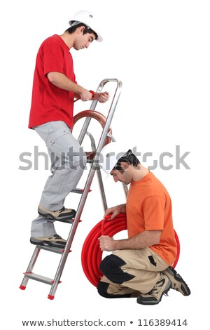 Tradesmen installing copper and corrugated tubing Stock photo © photography33