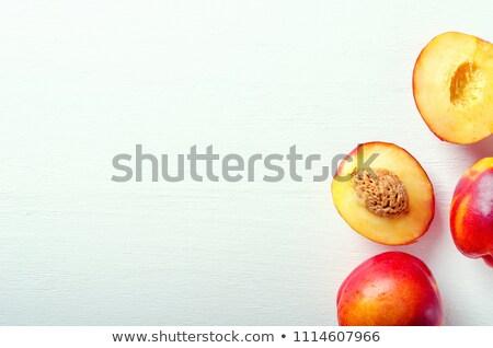 Friss fél nektarin asztal fa asztal gyümölcs Stock fotó © vetdoctor