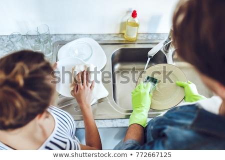 Caucasiano mulher pratos casa água feliz Foto stock © wavebreak_media