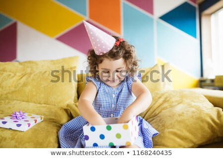 Little girl opening Birthday gifts at home Stock photo © wavebreak_media