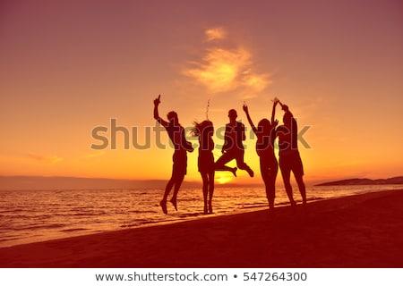Plage personnes silhouette mains amour femmes Photo stock © arturasker