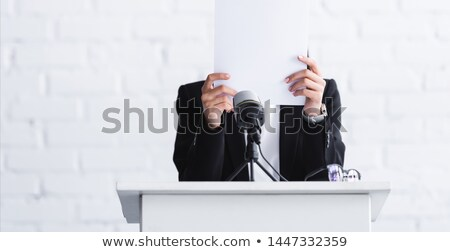 Unhappy woman standing behind a blank sign Stock photo © photography33