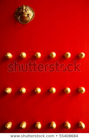 Riveter with red handles and red and gold rivets Stock photo © sarahdoow