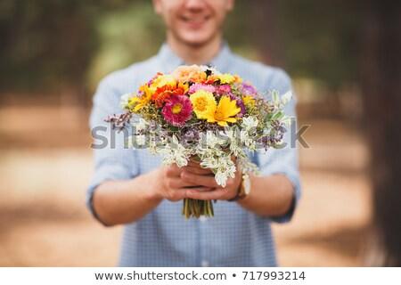 Portrait of man holding flower bouquet Stock photo © zzve