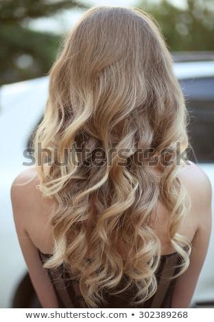 Loiro mulher cabelos cacheados posando colorido sorridente Foto stock © dash