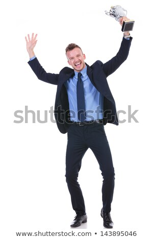 business man cheers with trophy in hand stock photo © feedough