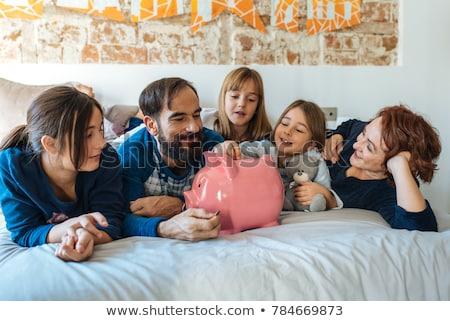Knuffelen spaarvarken cute vrouw witte geld Stockfoto © Rob_Stark