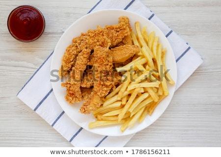 Frito crujiente pollo alimentos pierna Foto stock © M-studio