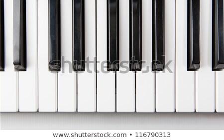 Pianotoetsen boven muziek piano zwarte leren Stockfoto © inxti