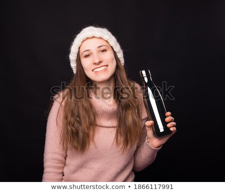 Young Woman Wearing Warm Winter Clothes Holding Hot Water Bottle Stock photo © monkey_business