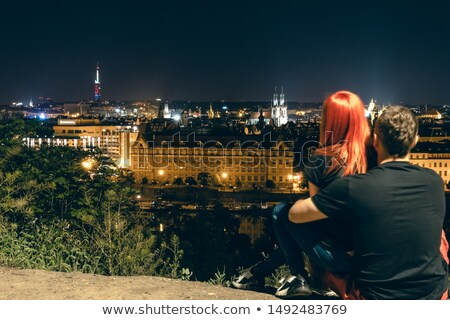 Stock photo: Beautiful blond girl in european old city at night time
