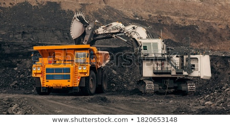 excavator loading rocks at quarry Stock photo © phbcz
