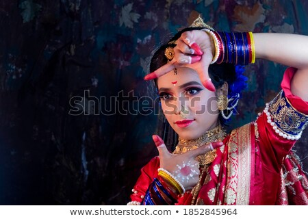 Indian young woman looking through finger frame Stock photo © bmonteny