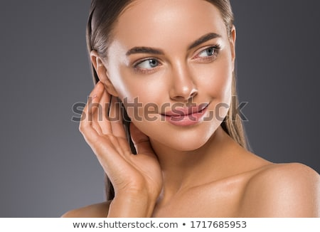 Young female with clean fresh skin, white background Stock photo © Nobilior