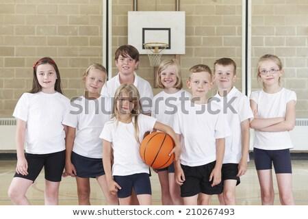 Alunos escola primária basquetebol equipe escolas esportes Foto stock © HighwayStarz