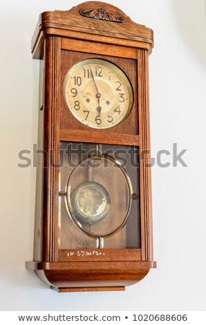 Velho relógio isolado branco mão Foto stock © Mikko
