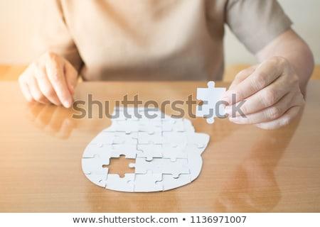 Health - Puzzle on the Place of Missing Pieces. Stock photo © tashatuvango