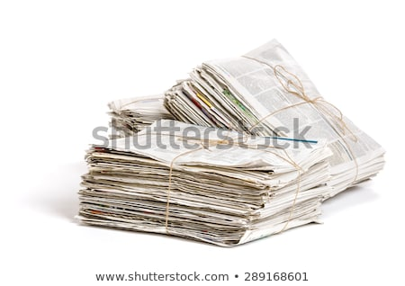 Stock photo: Some bundles of newspapers on a white background