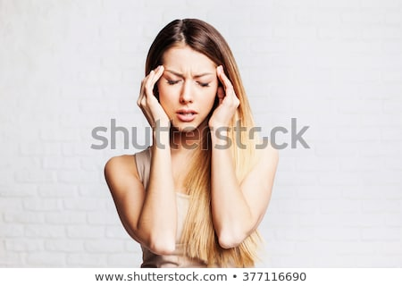 Stock photo: Attractive woman having headache