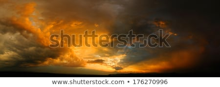 stormy sky with a dramatic sunbeams stock photo © cipariss
