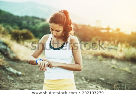 Sports woman using fitness tracker  Stock photo © deandrobot