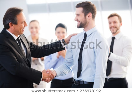 Two young businessmen greet Stock photo © Paha_L