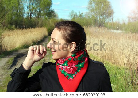 Beautiful joyful woman with kerchief. mountains in background. Stock photo © Paha_L