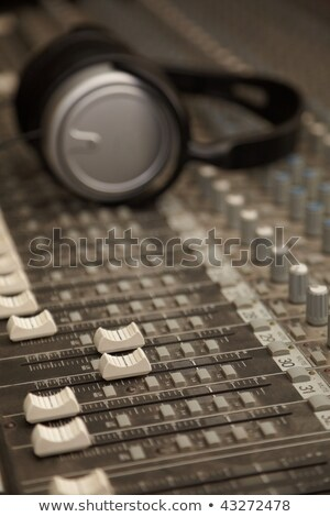Two faders of old dirty sound mixer in focus. headphones in out of focus Stock photo © Paha_L