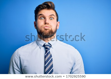 Businessman with inflated cheeks Stock photo © cherezoff