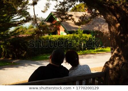 Doğa oturma bank erkek kadın Stok fotoğraf © zurijeta