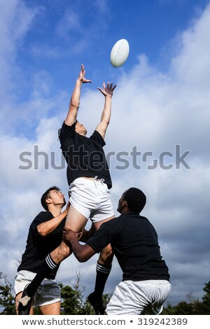 Rugby player catching a rugby ball Stock photo © wavebreak_media