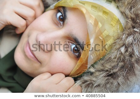 Asian arabic muslim woman with significant winter clothes Stock photo © zurijeta