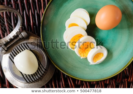 Boiled egg and a cutter Stock photo © Digifoodstock