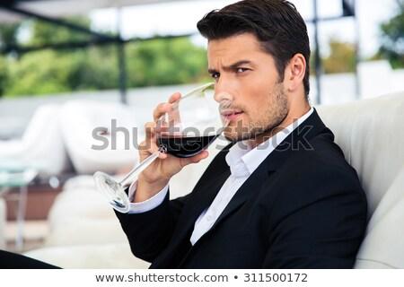 Jóképű férfi borospohár pirítós portré fiatal fickó Stock fotó © NicoletaIonescu